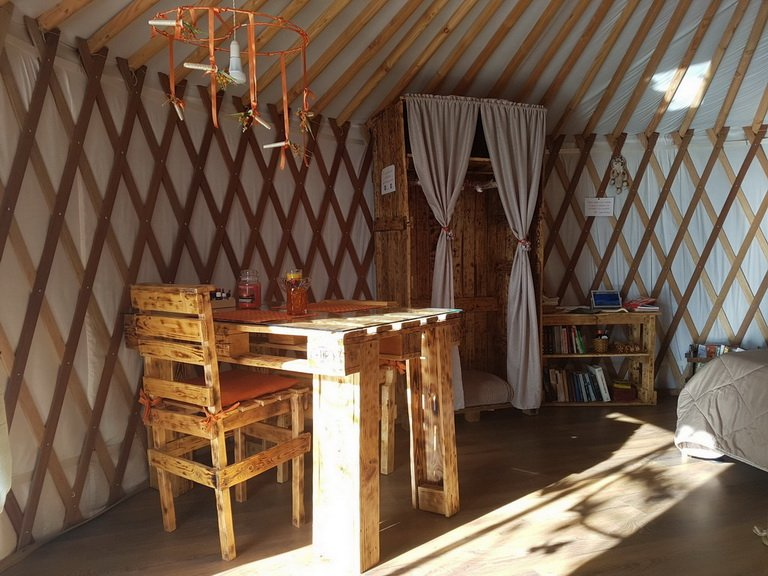 yurt with table and cupboard